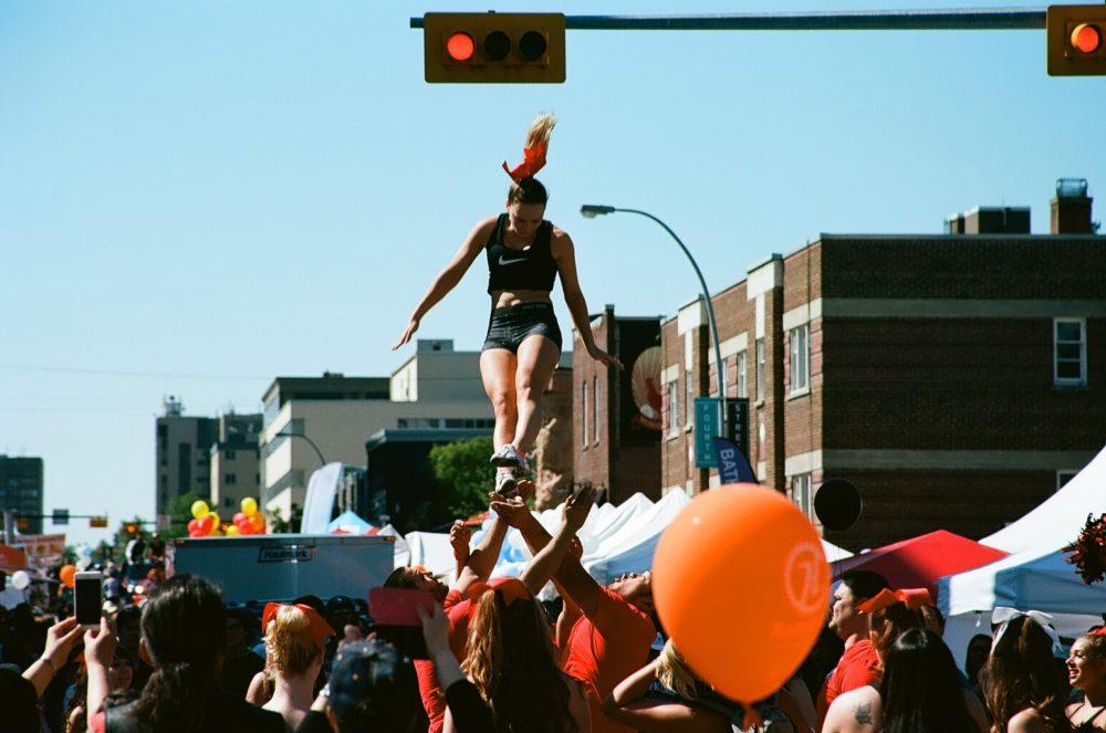 UC Dinos Cheerleaders perform aerials