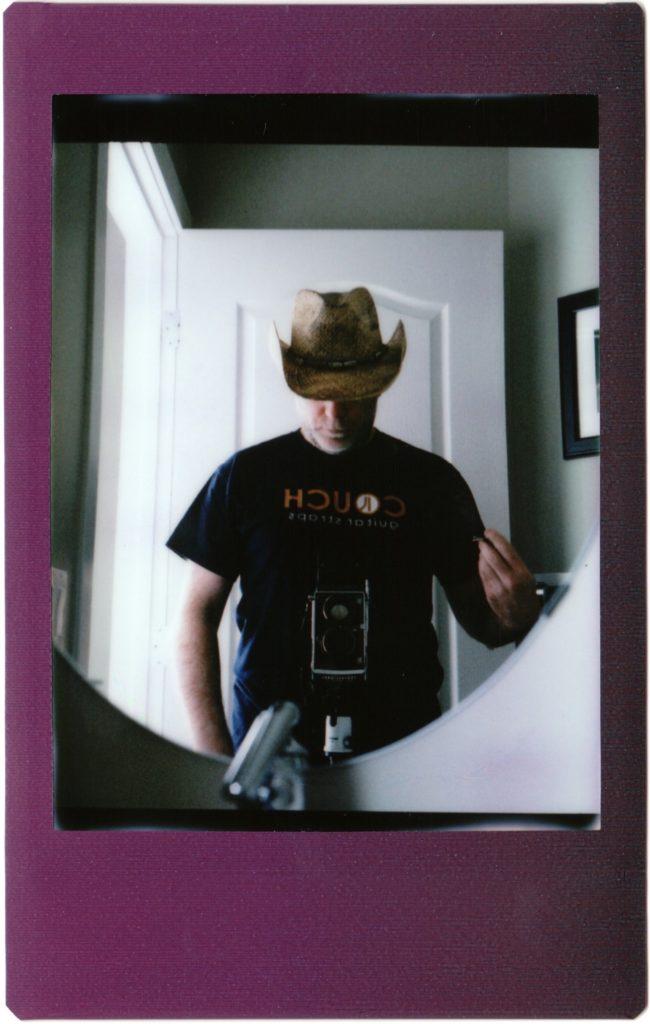 cowboy selfie (first attempt) shot with Mamiya C220 on Instax Mini film