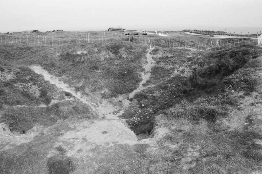 bomb crater at Pointe du Hoc