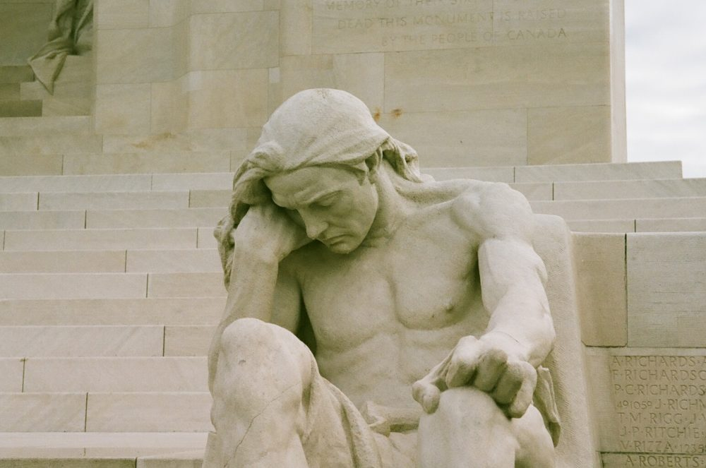 statue of male mourner at Vimy Memorial