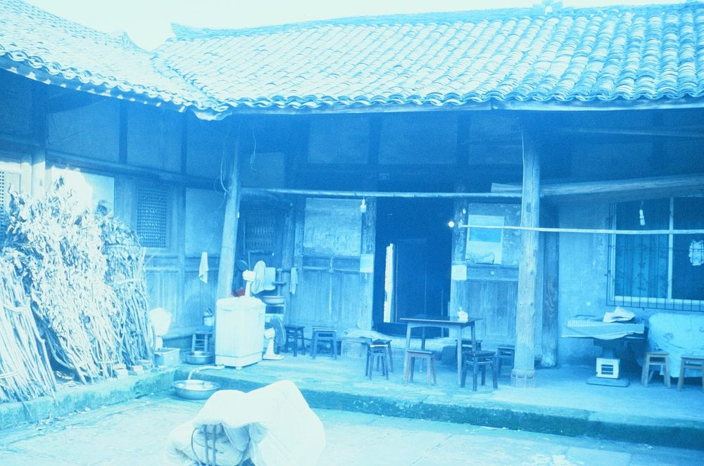 the courtyard of an old home in Emeishan, China