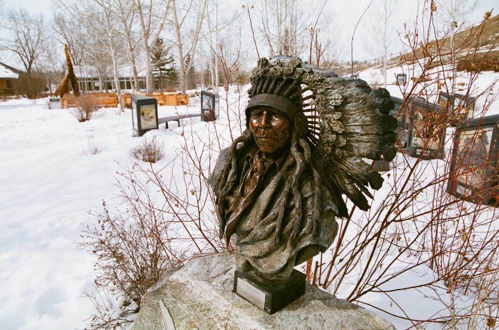 First Nations statue in Artisan Gardens at Bow Valley Ranch