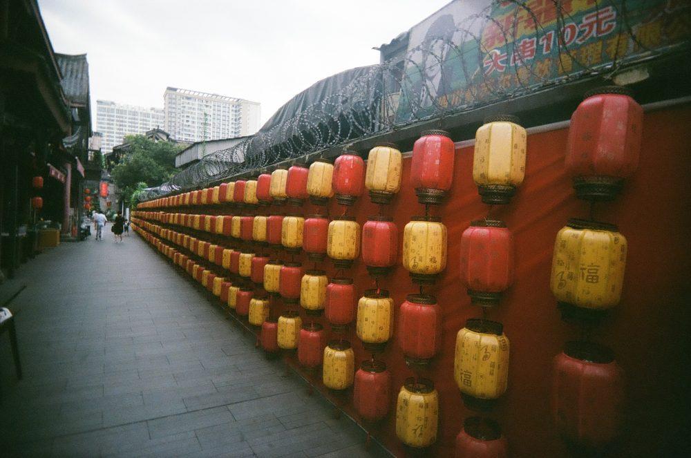 lanterns & razor wire outside Chengdu People's Park